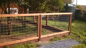 hog wire redwood fence
